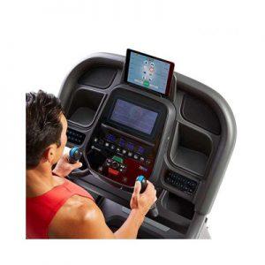 Man using Horizon 7.8 AT Studio Series Folding Treadmill